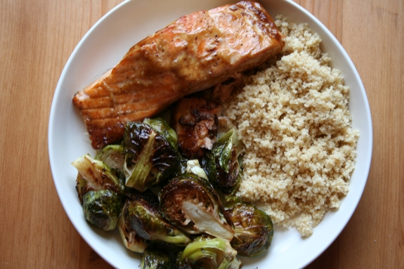 Baked salmon with couscous and roasted brussels sprouts