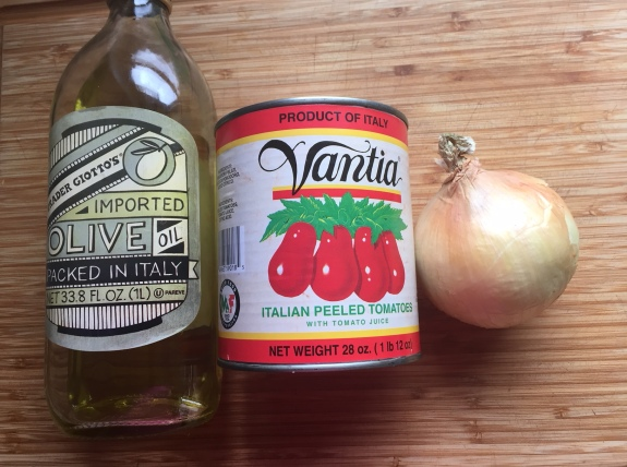 Olive oil, tomatoes and an onion