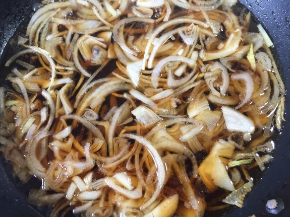 Sliced onions in dashi stock