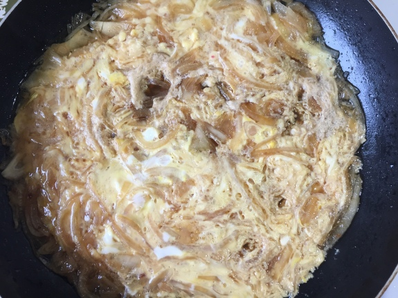 Cooked egg onion and dashi stock